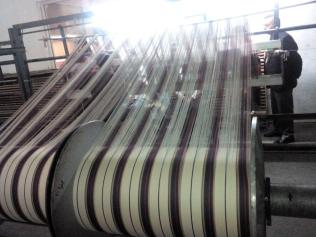 175924-Cloth being woven up